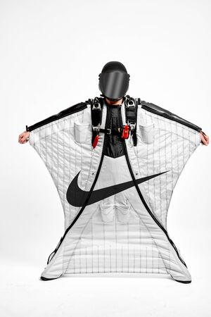 Nike. Men in wing suit demonstrations popular brands. Men simulates of free fall.