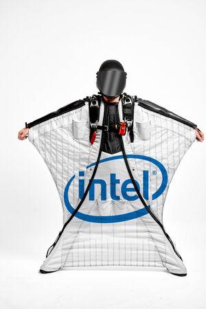 Intel. Men in wing suit equipment.Demonstration of popular brands. Simulator of free fall.