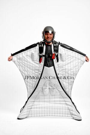 J.P. Morgan. Men in wing suit equipment.Demonstration of popular brands. Simulator of free fall. Stock Photo
