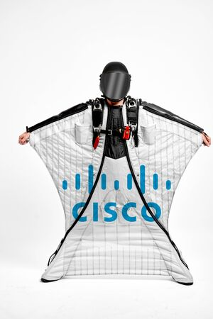 Cisco. Men in wing suit demonstrations popular brands. Men simulates of free fall.