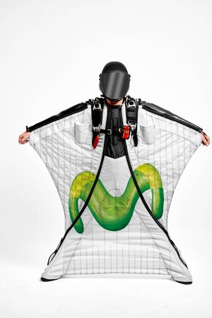 Movistar. Men in wing suit demonstrations popular brands. Men simulates of free fall.