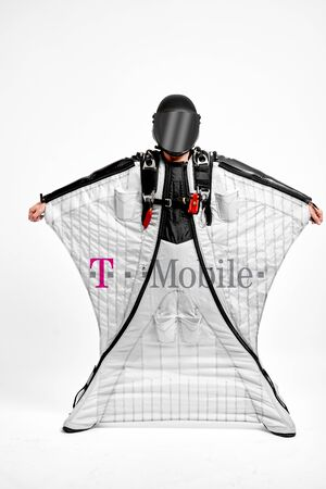 T Mobile. Men in wing suit demonstrations popular brands. Men simulates of free fall.