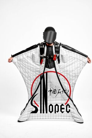 Sinopec. Men in wing suit demonstrations popular brands. Men simulates of free fall.