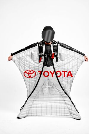Toyota. Men in wing suit demonstrations popular brands. Men simulates of free fall.