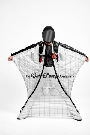 Disney. Men in wing suit demonstrations popular brands. Men simulates of free fall.  Banco de Imagens