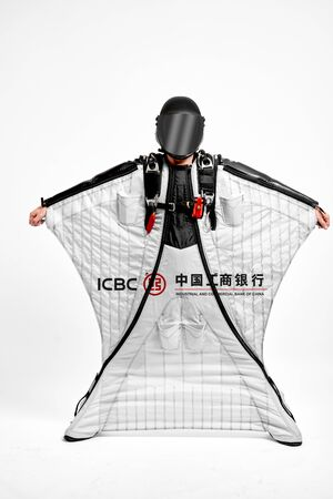 ICBC. Men in wing suit equipment.Demonstration of popular brands. Simulator of free fall.