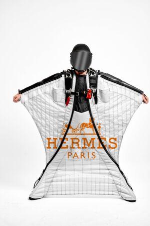 Hermes. Men in wing suit equipment.Demonstration of popular brands. Simulator of free fall.