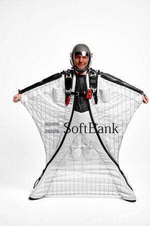 SoftBank. Men in wing suit equipment.Demonstration of popular brands. Simulator of free fall.