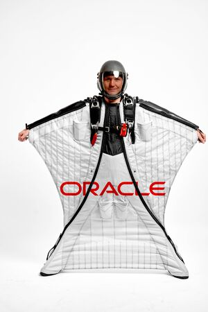 Oracle. Men in wing suit equipment.Demonstration of popular brands. Simulator of free fall.