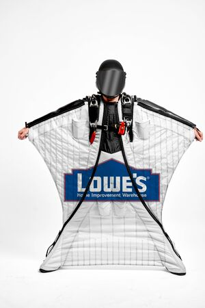 Lowes. Men in wing suit equipment.Demonstration of popular brands. Simulator of free fall.