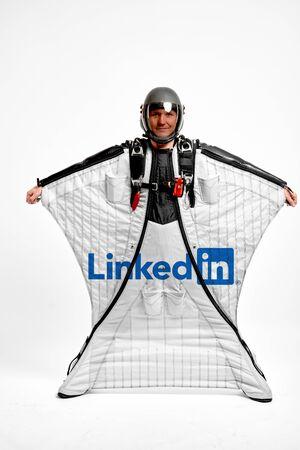 LinkedIn. Men in wing suit equipment.Demonstration of popular brands. Simulator of free fall.