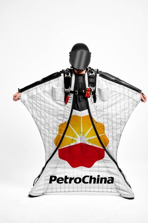 Petrochina. Men in wing suit demonstrations popular brands. Men simulates of free fall.