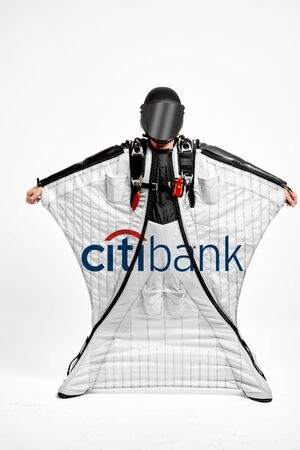 Citibank. Men in wing suit demonstrations popular brands. Men simulates of free fall.