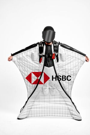 HSBC. Men in wing suit demonstrations popular brands. Men simulates of free fall.