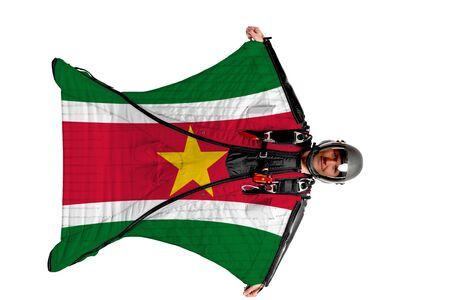 Surinam flag. Men in wing suit templet. Skydiving men in parashute. Simulator of free fall.