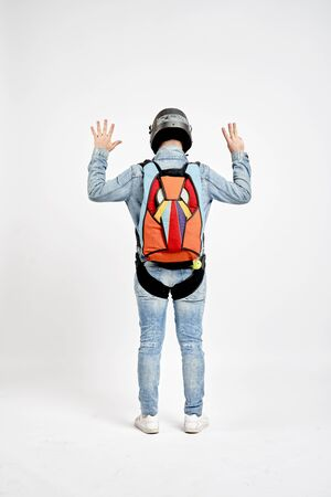 Eight fingers. Men in parachute shows eight fingers. Gesture by fingers. Skydiving sport.