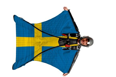 Sweden flag. Men in wing suit templet. Skydiving men in parashute. Simulator of free fall. Stock fotó - 138197678