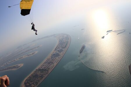 Adrenaline. Free people prefere active sports. Bird men conquers sky. Flying people in black suit. Extreme as a hobby.