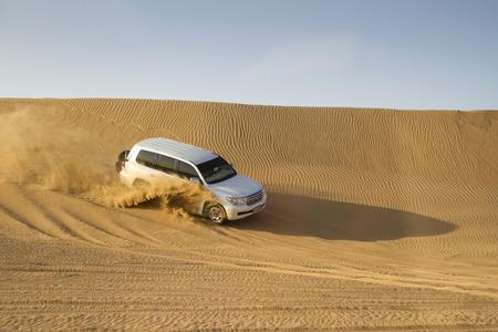 Dubai, UAE - October 30 - Desert safari, also called dune bashing, in DUBAI, UAE on October 30, 2013  Desert safari is a popular activity among tourists in Dubai