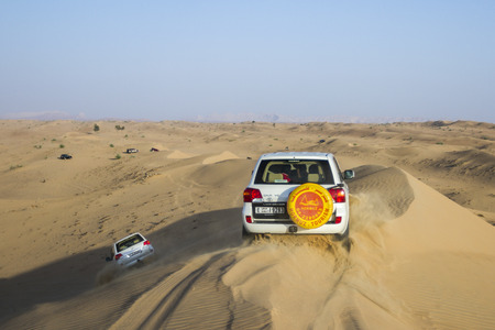 Dubai, UAE - October 30 - Desert safari, also called dune bashing, in DUBAI, UAE on October 30, 2013  Desert safari is a popular activity among tourists in Dubai