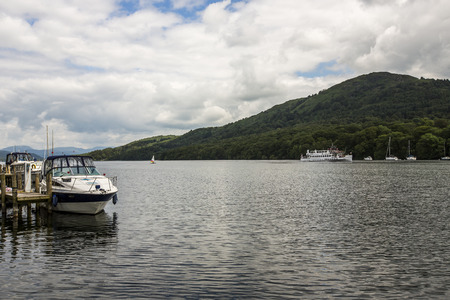 Windermere, England  - June 14  Small boats on lake Windermere, on June 14, 2014, in Windermere, Lake District, England  Windermere is the largest natural lake in England