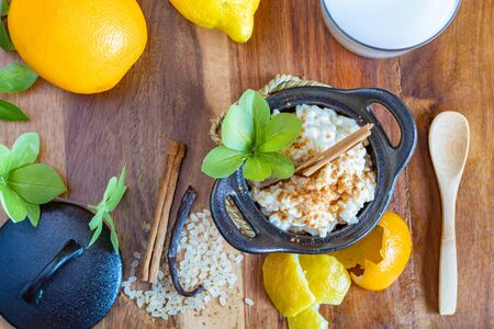 Homemade rice pudding dessert with lemon, orange and cinnamon flavor
