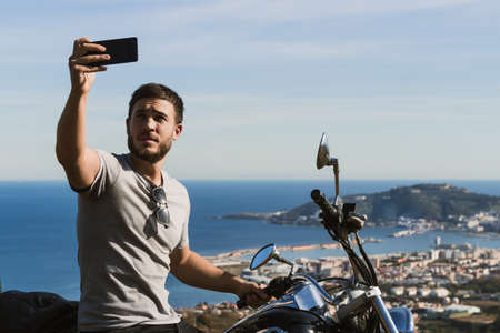Biker taking a selfie with the landscape during a route