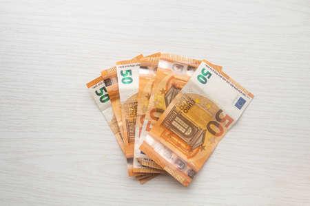 Euro cash banknotes on white table Stock fotó