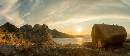 Panoramic photograph of the sunset over the coastal and mountainous area Stock fotó