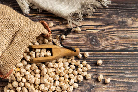 Sack of chickpeas on wooden table. Overhead view