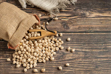 Sack of chickpeas on wooden table. Overhead view 2