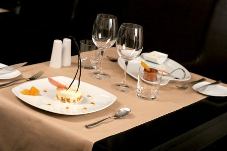 diferent: restaurant table with two diferent dessert