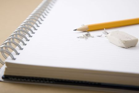 leftovers: pencil, eraser and eraser leftovers on notebook Stock Photo
