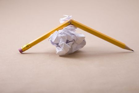 scrunch: crumpled paper and crushed yellow pencil Stock Photo