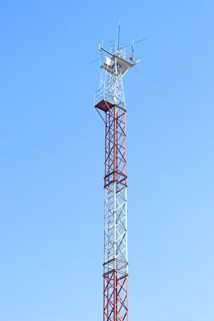 Cellular communication antena and blue sky background photo