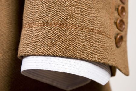 suit  cuff: closeup of suit, detail of brown cuff and white shirt Stock Photo