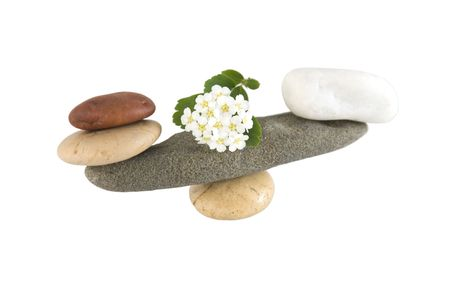 Front view of balancing stones over a white background with reflection Stock Photo - 6965039