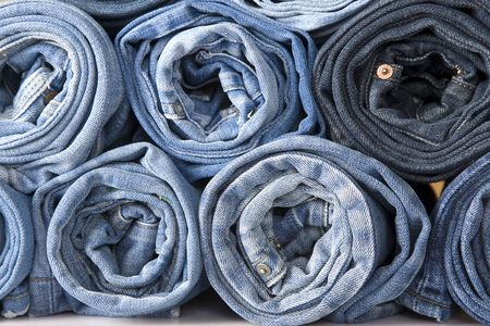 denim: roll blue denim jeans arranged in stack