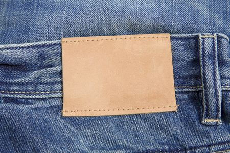 front view of denim label, blue jeans and leather label photo