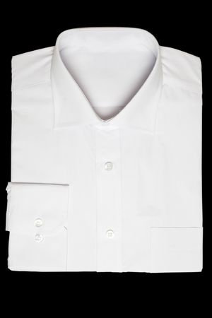 formal shirt: front view of new white shirt on black background Stock Photo