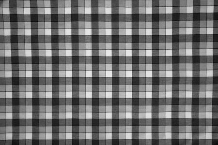 checked fabric: detail of fabric print with black and white grid Stock Photo