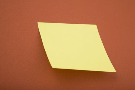 yellow tacks: blank yellow post it on red background