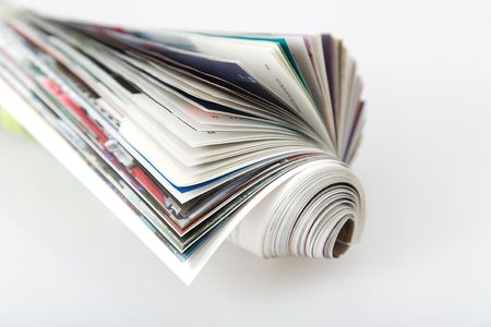 front view of roll magazine, colored newspaper on white background Stock Photo - 7024117