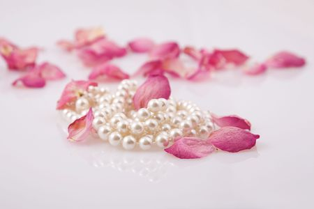 beads: fine pearl beads and red roses petals
