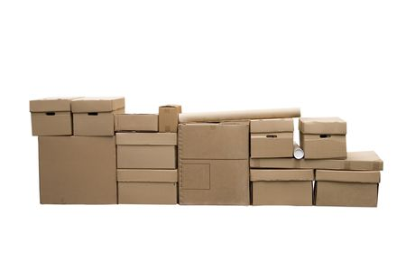 Brown different cardboard boxes arranged in stack on white background photo