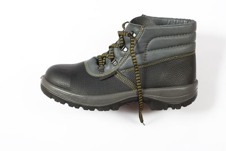 new black footwear, equipment for workers on white background photo