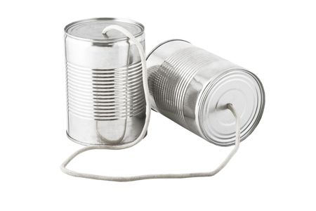 Closeup of tin cans telephone connected by string on white background, business communication concept  photo