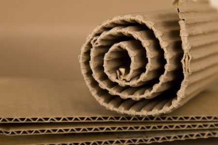 corrugated cardboard: close-up of spiral made from brown cardboard