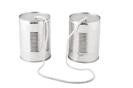 Closeup of tin cans telephone connected by string on white background, business communication concept Stock Photo - 7182402