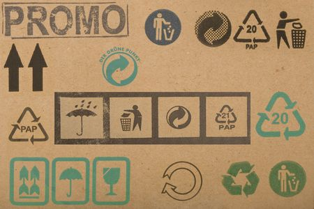 different symbols from cardboard boxes, information labels photo